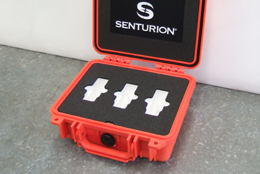 Small orange Peli case with custom shadow foam and branding