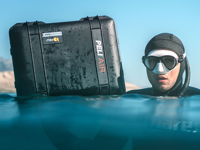 A diver with a Peli Air 1557 case