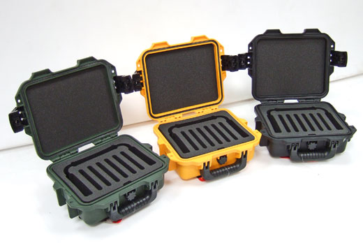 Three compact Peli Storm cases